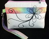 Small, free machine embroidered pouch with detachable wrist strap