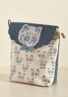 <p>Expect this cat-printed makeup bag to go unnoticed? Surely you jest! This faux-leather cosmetics pouch from Disaster Designs commands attention with its navy scalloped flap topped with a bow-tied, bell-wearing feline, dotted backside, and easy-to-clean interior. 'Meow' about that!</p>
