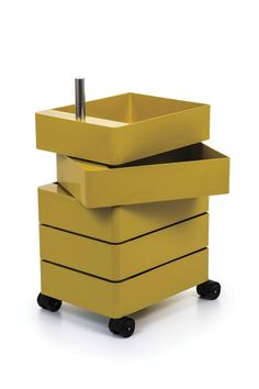 Who knew that storage could be so much fun? The 360-Degree Container (2010) is a smooth-moving, swiveling stack of drawers that offers a functional solution for work, school, sewing, or craft needs. Each drawer swivels 360 degrees to reveal or hide its contents, and provide easy access to everything inside. Say farewell to things stuck in backs of drawers – with this mobile organization tool, each drawer is entirely visible and accessible. Made in Italy.  Yellow : 360 Degree Container. Moving Containers, Storage Containers, Container Design, Container Store, Pods Moving, Design Bestseller, Self Storage, Design Within Reach, Office Storage