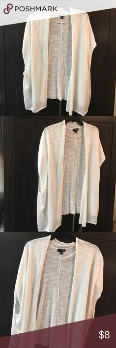 🌺🌺Gently used lightweight cardigan🌺🌺 Gently used white cardigan. I purchased from another posher but never got to wear it due to My recent weight loss. Has wide open sleeves. Your gain!🎉🎉I offer discounts on bundles and accept reasonable offers except on items $10 & under🎉🎉🚫No low ball offers as my prices are very reasonable. 🚫No trades and 🚫pay pal. Thank you for shopping my closet and happy Poshing! 😘😘😘 a.n.a Tops
