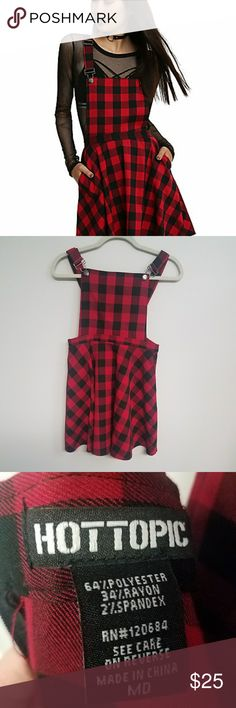 """HOT TOPIC RED & BLACK Plaid Overall Dress Great Condition, and still available in stores!! Features adjustable straps, two pockets, and a back zipper  Aprox measurements Length:top of bib to hem  27"""" Sweep: seam to seam on hem  38"""" Hot Topic Dresses Midi"""