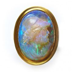 A Victorian opal cameo ring, the oval opal carved in the form of a bearded man with Roman helmet, Circa 1870