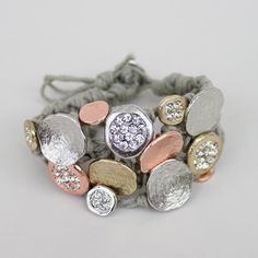 I can't believe this is a button bracelet! I used to make these in college (back in the early 90s). A cool new iteration.