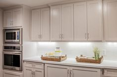 As seen on Fixer Upper, Rustic touches add a charming country feel in this sparkling new white kitchen.