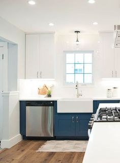 Add creativity to your kitchen by trying a dual color scheme! These blue and white cabinets are modern and fun but still timeless. Kitchen Cabinet Colors, Kitchen Colors, Kitchen Ideas, Marble Countertops, Kitchen Countertops, Kitchen Cabinets, Quality Cabinets, Low Cabinet, Contemporary Kitchen Design