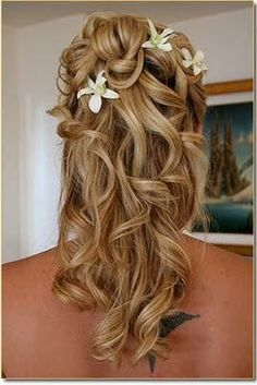 Beautiful curly half up half down with flowers but I would have roses.