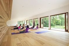 This gorgeous yoga studio has natural wood wrapping from the floor to the ceiling in a beautiful seamless motion.   Check out 80 yoga studio design tips at http://www.homestratosphere.com/yoga-studio-design-tips/  Design: http://www.blueforest.com/