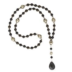 This 54-bead Obsidian, Tourmaline, Jet, and Pyrite mala works with the Root (1st), Third Eye (6th), and Solar Plexus (3rd) chakras.