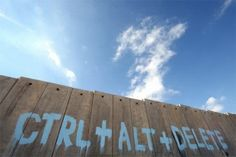 sokak banking Filippo Minelli painted this CTRL+ALT+DELETE text on the dividing wall between Israel and Palestine in the West Bank, near the Qalandiya checkpoint, in 2007 West Bank Wall, International Court Of Justice, Apartheid, Tumblr, Berlin Wall, Italian Artist, Environment Design, Street Art Graffiti, Banksy