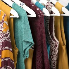 Warm up your wardrobe with three of our favorite hues for the upcoming season: mustard, teal, and burgundy.
