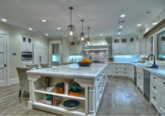 """The marble slabs in this kitchen are called """"Calacutta Premium""""  Wire brushed oak floors"""
