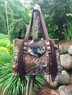 The Buckaroo Tote with hand cut fringe, the owner's brand in turquoise suede on the flap, all stitched up in brown leather lace.  Lined with two interior pockets. gowestdesigns.us www.etsy.com/shop/GoWestDesigns