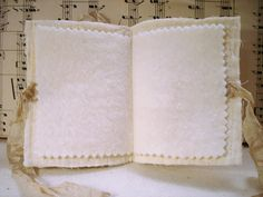 Needle book.  From the-feathered-nest.blogspot.com.  I think free image.  lj