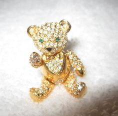 SOLD! The adorable gold and crystal articulated bear! One of almost 40 pins we bought at the Joan Rivers' estate auction--these were her favorite pins that she actually wore, from her personal jewelry box! These pins make wonderful gifts or treat yourself to a piece of history from a true queen of comedy, wonderful designer and savvy business woman. All beautiful, all conversation pieces, all fascinating collectibles and all high quality jewelry!