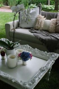 Take an old picture frame, secure it on top of a coffee table and paint it the same shade. Shabby chic!