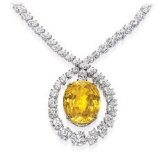 Harry Winston-Yellow Sapphire and Diamond Necklace Oval yellow sapphire, 43.38 carats; 118 marquise, round brilliant and pear-shaped diamonds, 34.44 total carats; 18k yellow gold and platinum settings.