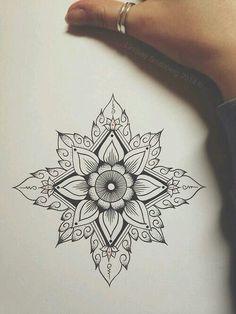 Symmetrical flower tattoo idea