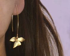 Wild Orchid solo flower earrings in gold . Single gold orchid and a long earwire
