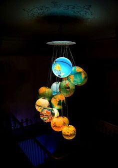 "Beautiful ""chandelier"" made of 15 world globes. I've searched everywhere even for single glowing globe! Desk Globe, Globe Lamps, Globe Chandelier, Globe Lights, Chandelier Lighting, Chandeliers, Globe Art, Solar Chandelier, Globe Decor"