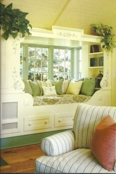 I think I could make a bed in the guest room with this concept.  Window Seat w/ Built-in Bookshelves