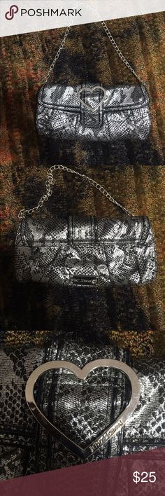 """Betsey Johnson Purse This is a Betsey Johnson purse with a chain handle.  As you can tell in the pictures it in in excellent condition.  It measures 12"""" x 6"""".  This is a re-posh sale for me only because the purse is to small for me I cannot begin to fit all my stuff in this handbag.  I did not even use it once. Betsey Johnson Bags Shoulder Bags"""