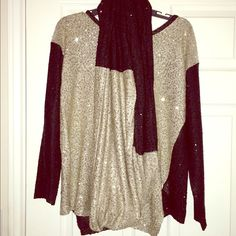 DKNY NY Sequined Black/Gold Tunic And Scarf Beautiful colorblock forward seamed sequined tunic, black and cream/gold color with matching yarn infinity scarf.  The possibilities are endless with wearing the scarf with a plain black shirt or matching tunic or tunic alone.  Two guaranteed classic showstoppers!  Bring on the compliments!   No rips or tears, excellent condition for both!   It is a small but runs large. I tend to wear a medium. Tops Tunics