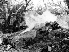 Marines directing flame throwers at Japanese defenses that block the way to Iwo Jima's Mount Suribachi on March 1945 during World War II. On the left is Pvt. Richard Klatt, of North Fond Dulac, Wis., and on the right is PFC Wilfred Voegeli. Nagasaki, Hiroshima, Battle Of Iwo Jima, Us Marines, Pearl Harbor, Military History, Ww2 History, Military Humor, Blanco Y Negro