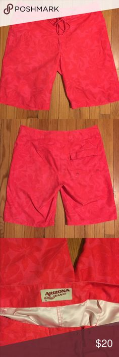 "Men's swim trunks Arizona Jeans men's swim trunks. Coral shorts with darker coral flower print. Velcro and drawstring closure. 2 front pockets and 1 back pocket with Velcro closure. Waist 36"", inseam 11""  EUC ⭐️I love offers⭐️ Arizona Jean Company Swim Swim Trunks"