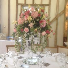 A pretty in pink wedding, centre pieces in cocktail vases - For more info on weddings, call 01394 385 832 or visit our website for floral ideas @ www.trianglenursery.co.uk