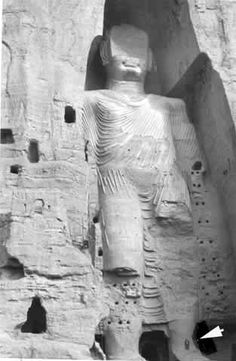 """Afghanistan Photo: Emmalee Tarry. Caption on this photo from 1977  says, """"Anne is standing on the left foot."""" The two colossal statues of the Buddha in the Bamiyan Valley were destroyed by the Taliban."""