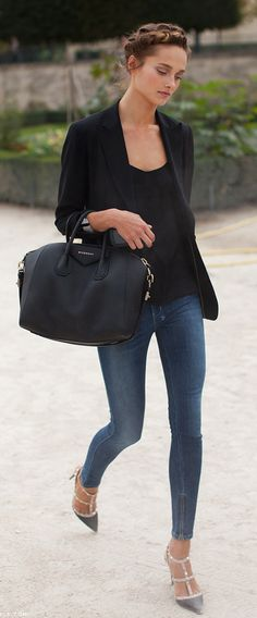 Simple chic with a black blazer, tank, jeans, black leather bag, and studded shoes.