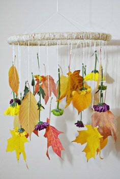 This clever floral mobile is an interesting take on fall. Plus, it mimics the feel of a wreath, but with a more youthful spin. Hang real dried flowers and leaves from the ring of your mobile and hang it up somewhere that in a room that needs a little festive flair. Click through for the tutorial and more fall decorations.
