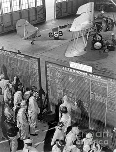 November 1942 - Aviation cadets check flight boards for last minute instructions at NATC, Corpus Christi, Texas.