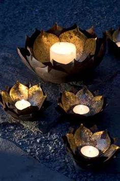 Use these golden bowls and tea lights to add soft lighting around your event