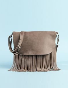 The Sedona Saddle in Fawn Taupe Vintage Tribe leather, with heavy emphasis on our favourite trend - fringe.