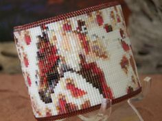 """This one of a kind American Indian beaded two inch cuff bracelet with my latest design """"Palomino Snow"""" is made with the blends of whites, reds and browns and finishing is a beautiful ruby edge. The pa"""