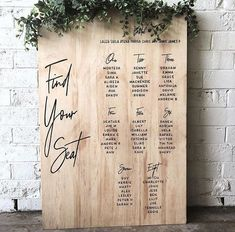 Modern minimalist wooden table plan, decorated with simple yet sophisticated greenery