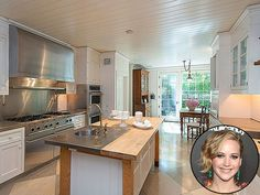 Look Inside These Gorgeous Celebrity Kitchens | JENNIFER LAWRENCE  | The Hunger Games star recently bought this 5,500-square-foot Beverly Hills home – which used to belong to Jessica Simpson – complete with a koi pond, a private, walled courtyard and a large kitchen with white accents.