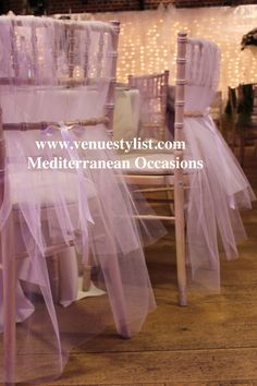 Wedding chair decor with soft tulle, adding a romantic look to the room. - I think something like this can be done to those plain black chairs - sc