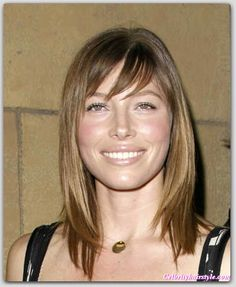 Cute mid-length hair with bangs. Nice color, too.