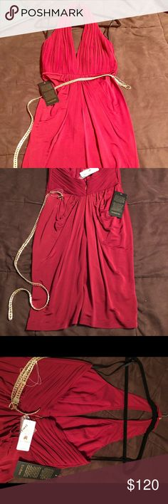A beautiful halter dress, never been worn. Halter dress, with belt. Never been worn, tags still on. bebe Dresses