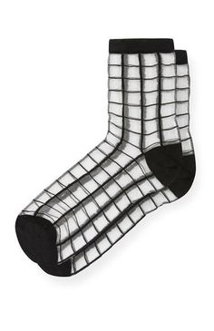Sheer socks with black grids. Free size.