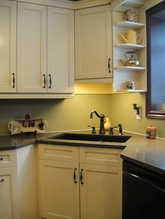 Corner sink  - UPPER CABINETS - PRETEND MIRROR IS AN OPENING INTO THE FRONT ROOM AND THE SETUP APPLIES FOR US