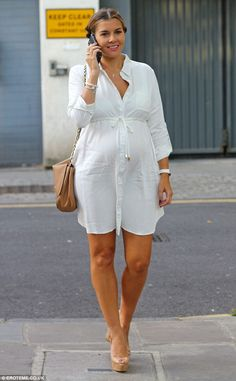 Blooming lovely: Imogen Thomas proudly paraded her growing baby bump as she headed out to dinner in London on Tuesday evening