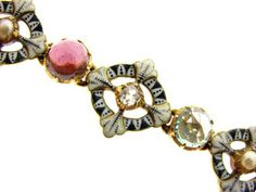 A gold and enamel gemset bracelet by Carlo and Arthur Giuliano, circa 1900.