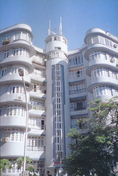 In better days --- Ram Mahal apartment building, 8 Dinshaw Wachha Road, Mumbai (Bombay). Designed by John Mulvaney, Scanned from Bombay Art Deco Architecture: A Visual Journey by Navin Ramani. Beautiful Architecture, Beautiful Buildings, Architecture Details, Art Nouveau, Bauhaus, Art Deco Movement, Art Deco Buildings, Building Art, Interesting Buildings