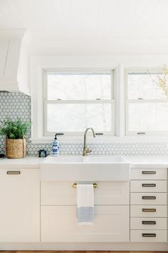 White kitchens are hugely popular right now thanks in part to their airy, de-cluttered feel. But perhaps the best thing about them is that they tend to morph to fit whatever aesthetic you choose. They don't just have to be minimalist, but can instead be coastal, rustic, contemporary, industrial, bohemian, vintage, or sleek — the adjectives can keep on rolling. Here, 25 dreamy white kitchens that bring something unique to the table.