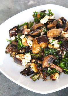 A delicious warm salad with roasted kale, mushrooms, and eggplant, tangy goat cheese, walnut and balsamic vinaigrette. It's the perfect side dish for cooler weather. (gluten-free, vegetarian)