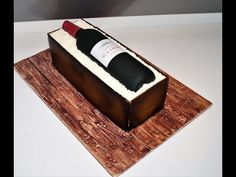 In my cake decorating tutorials, I will show you how to make a Wine Bottle in a Wood Crate cake . This birthday cake is perfect for a father's day cake . Bottle Cake, Fathers Day Cake, Cake Decorating Tutorials, Wood Crates, Cake Tutorial, Birthday Cake, Sweets, Wine, Cakes