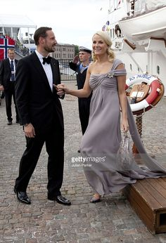 Crown Prince Haakon And Crown Princess Mette-Marit Of Norway Leave The Royal Yacht Ks Norge To Attend A Party At Drottningholm Palace Near Stockholm As Part Of The Pre Wedding Celebrations For Crown Princess Victoria Of Sweden And Daniel Westling. (Photo by Julian Parker/UK Press via Getty Images)